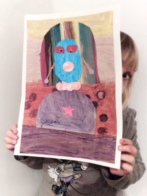 originale- collage-di -una-bambina-di- 6- anni-con -la- faccia-blu-che-rappresenta-il-suo-ritratto